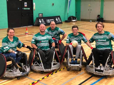 Team Photo showing 5 Newcastle Falcons players in Green and White hooped shirts