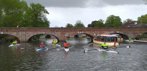 An adaptive squad outing showing 6 rowing boats