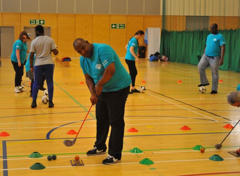Participant engaging in some indoor golf