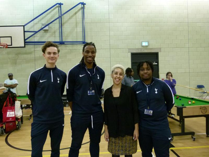 Four YMCA staff standing and smiling for a photo