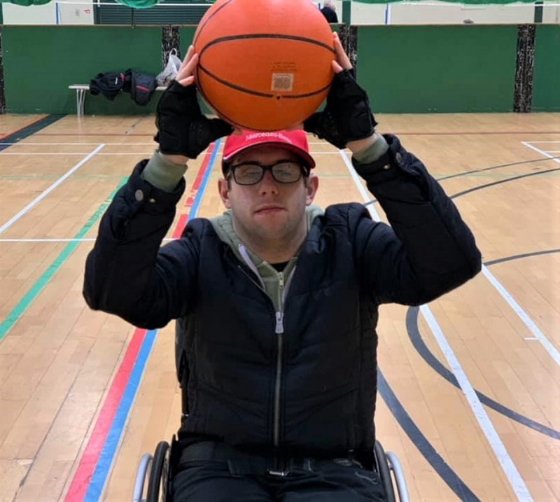 Jack (man in wheelchair) about to pass the ball