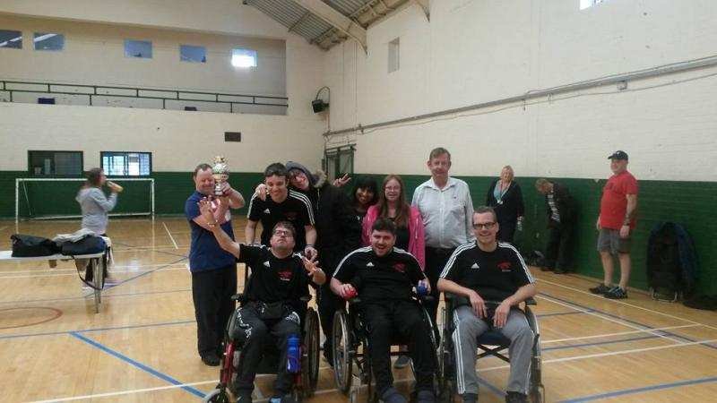 Group photo of Boccia Wirral team with winning trophy
