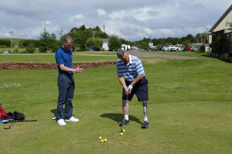 SDGC member getting some tips on his golf swing by a PGA pro