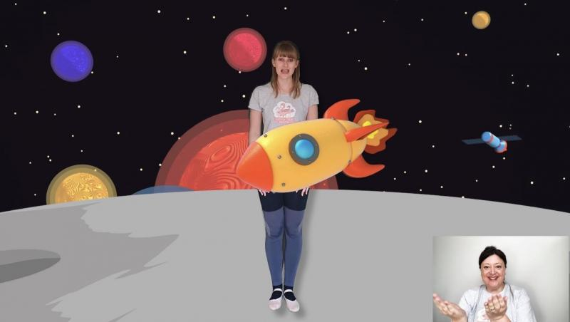 Photo of inclusive space themed dance class - rocket passing across dancer in the middle of the screen, whilst she stands on a planet. In the corner is a person signing using Makaton sign