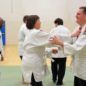 A group of people practicing judo