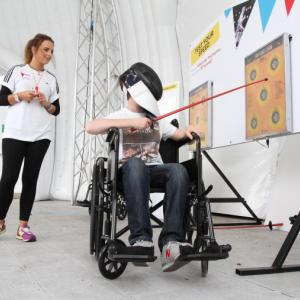A young person tries wheelchair fencing using a skill game