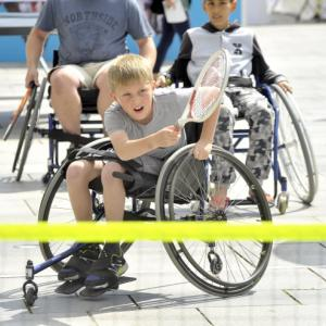 boy plays wheelchair tennis