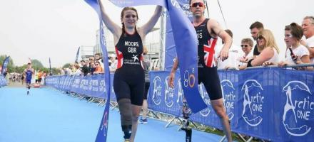Paralympic Champion Andy Lewis welcoming home Hannah Moore at the finish line