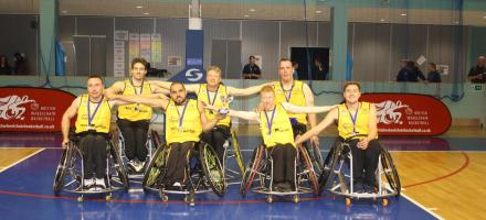team photo of Essex Outlaws Wheelchair Basketball with trophy